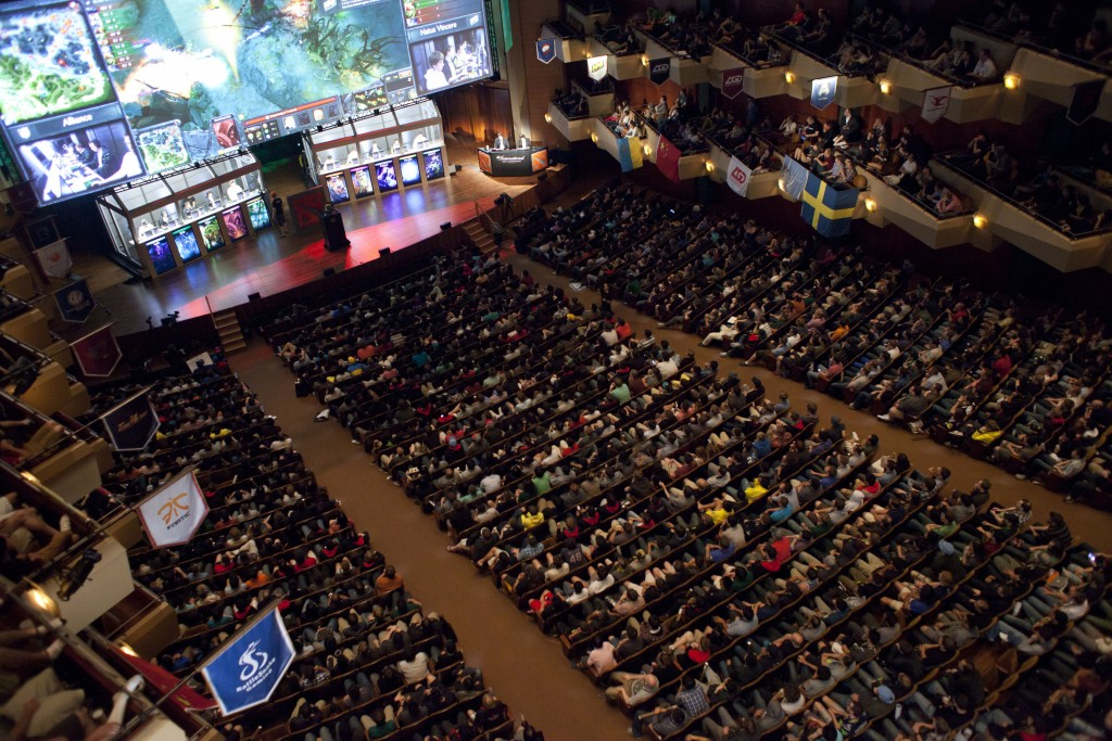 "A packed Benaroya Hall watches ""The Alliance"" battle ""Natus Vincere"" during ""The International"" Dota 2 video game competition in Seattle, Washington August 11, 2013. Sixteen teams from 12 countries battled for some $2.9 million in prize money, with Swedish team ""The Alliance"" claiming the top prize of $1.4 million after defeating Ukraine's ""Natus Vincere"" in a final watched by an audience of 1700 at Benaroya Hall and streamed live on the Internet. REUTERS/David Ryder (UNITED STATES - Tags: SOCIETY SCIENCE TECHNOLOGY)"